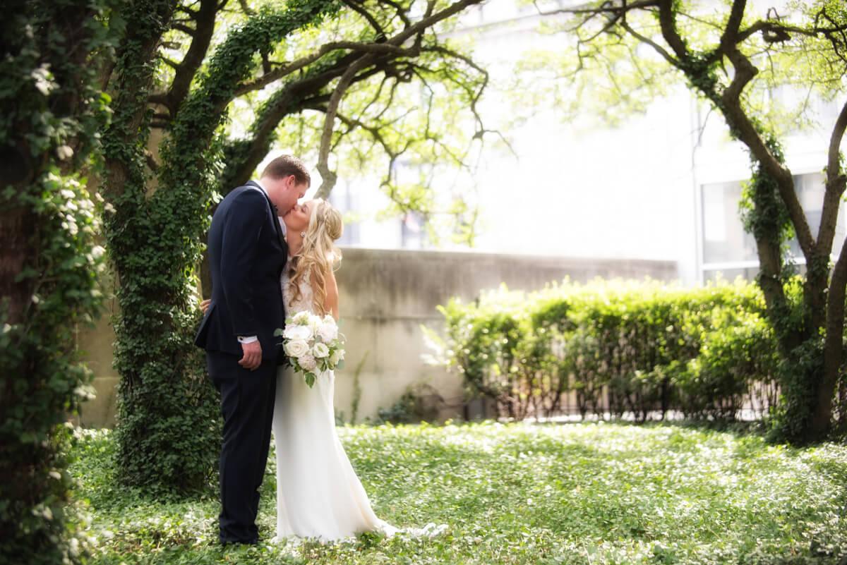 Romantic garden photo of bride and groom