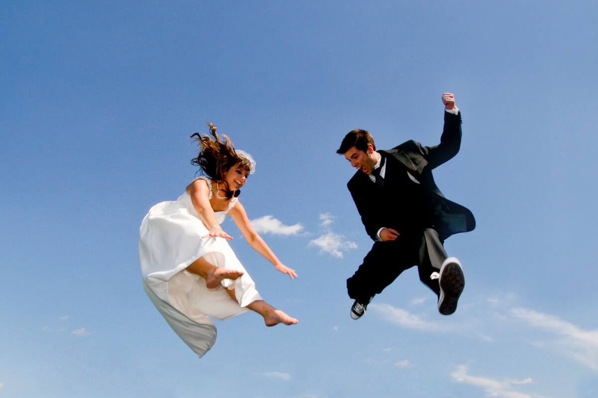 Bride and Groom fun trampoline photo
