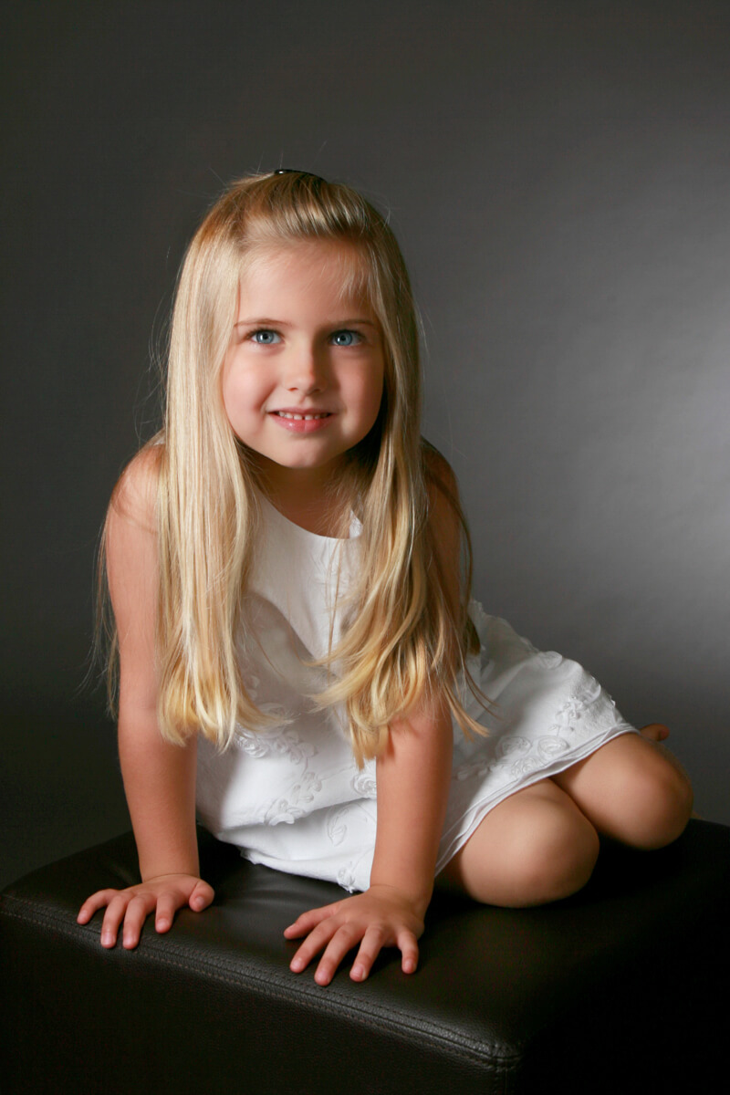Young girl with blond hair for in studio portrait