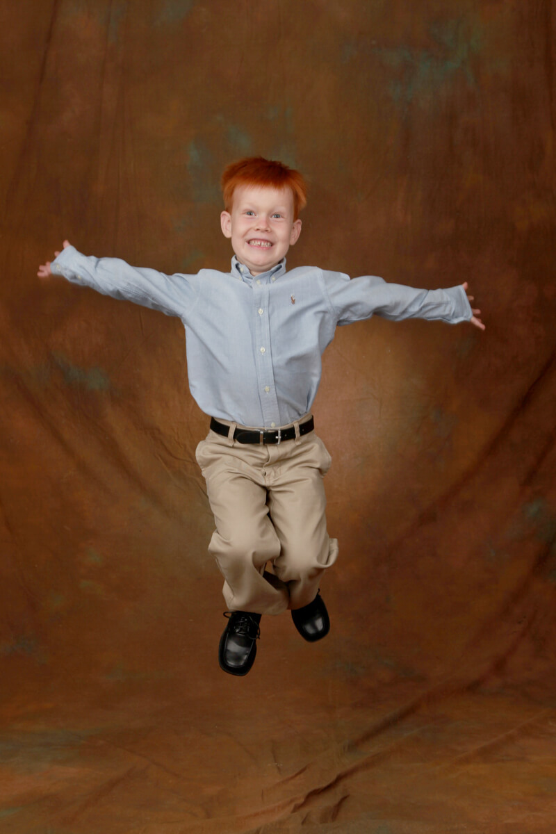 Boy jumping for portrait session