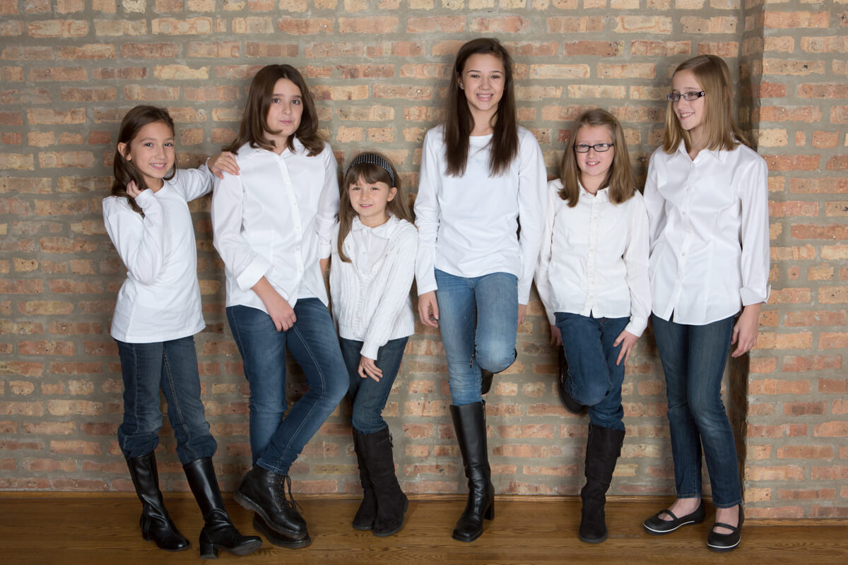 Cousins Portrait with a fun line up on brick wall