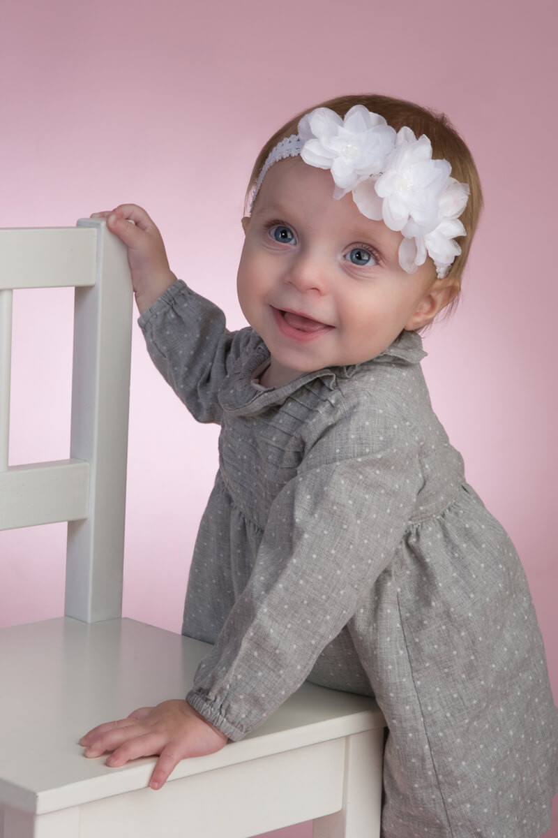Fun pink backdrop for baby portraits