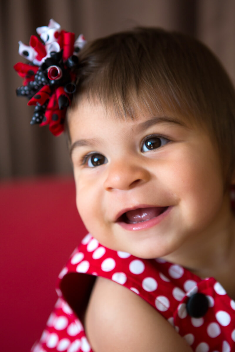 Smiling baby dressed in red white and blue
