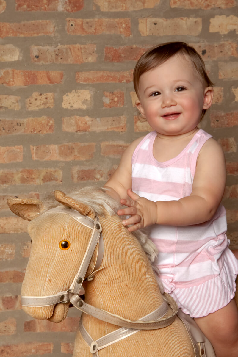 Rocking Horse Baby Portrait taken in studio