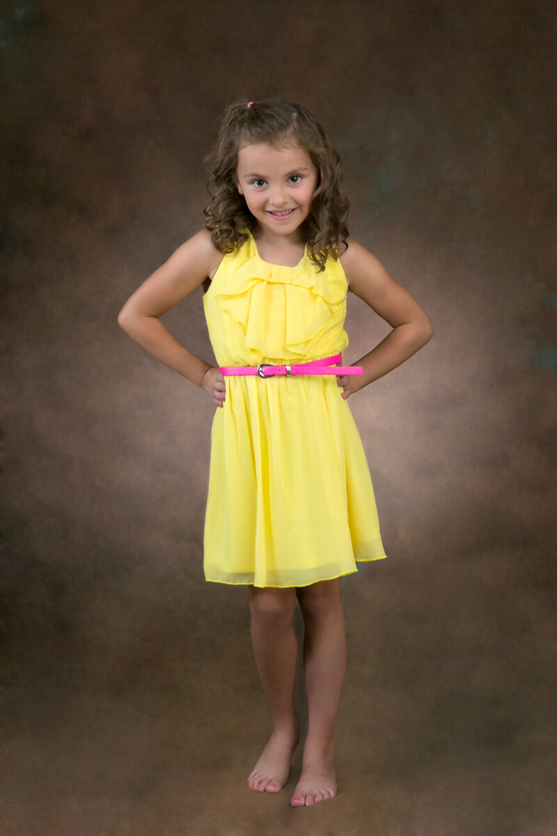 Fun pose of little girl for portrait session