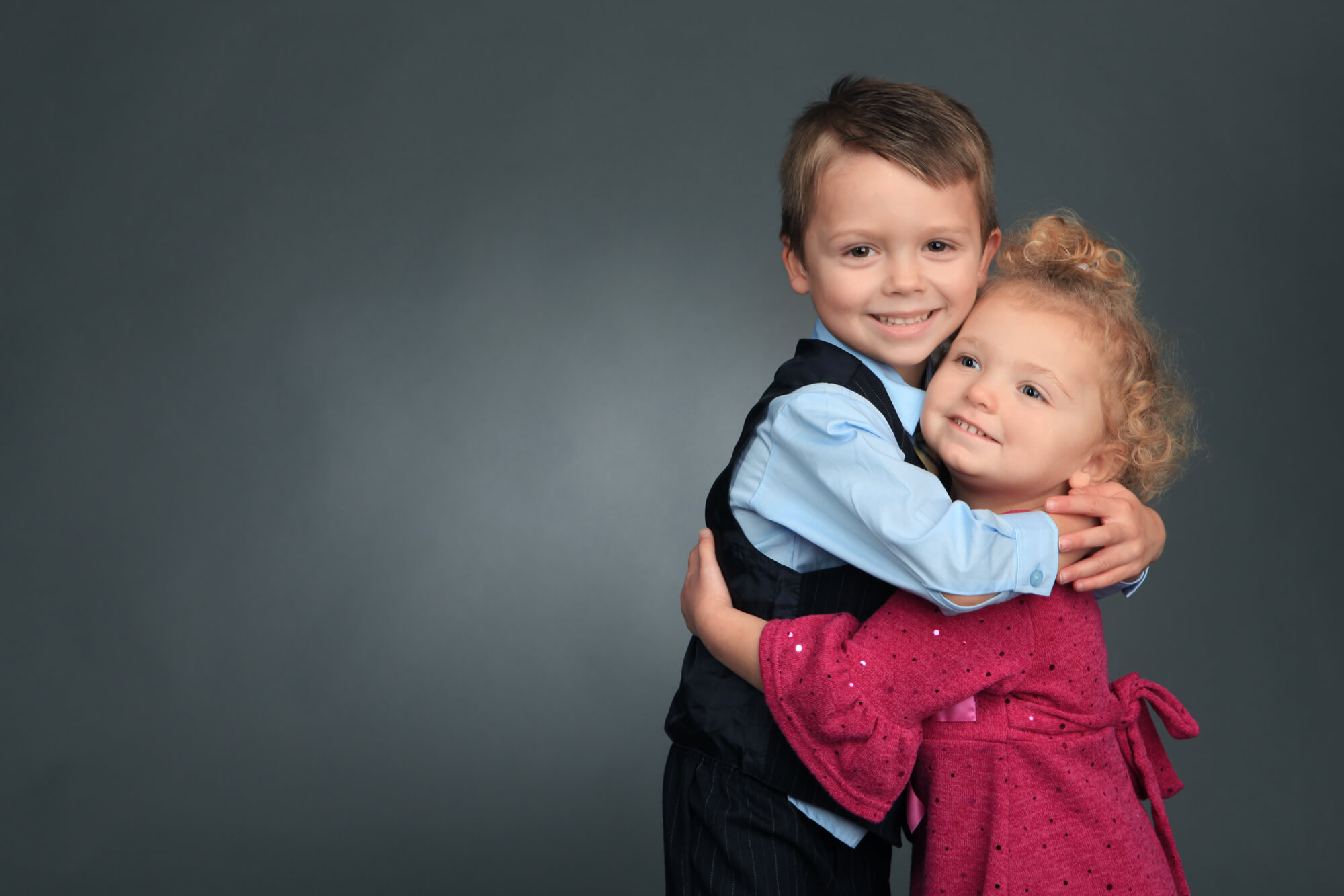 Siblings hugging during portrait session