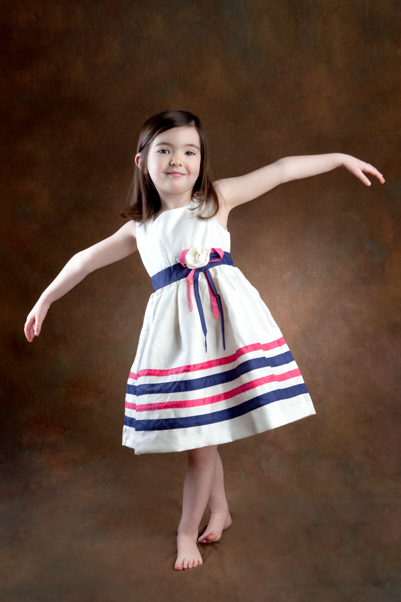 Girl twirling during portrait session