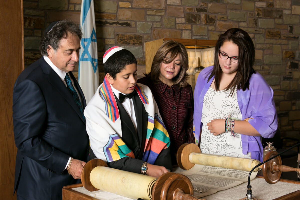 Family Reading Torah at Bar Mitzvah