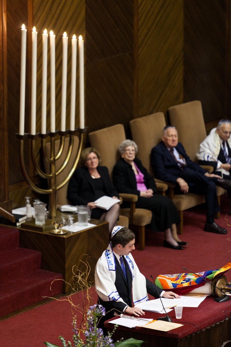 Creative photo of bar mitzvah with menorah