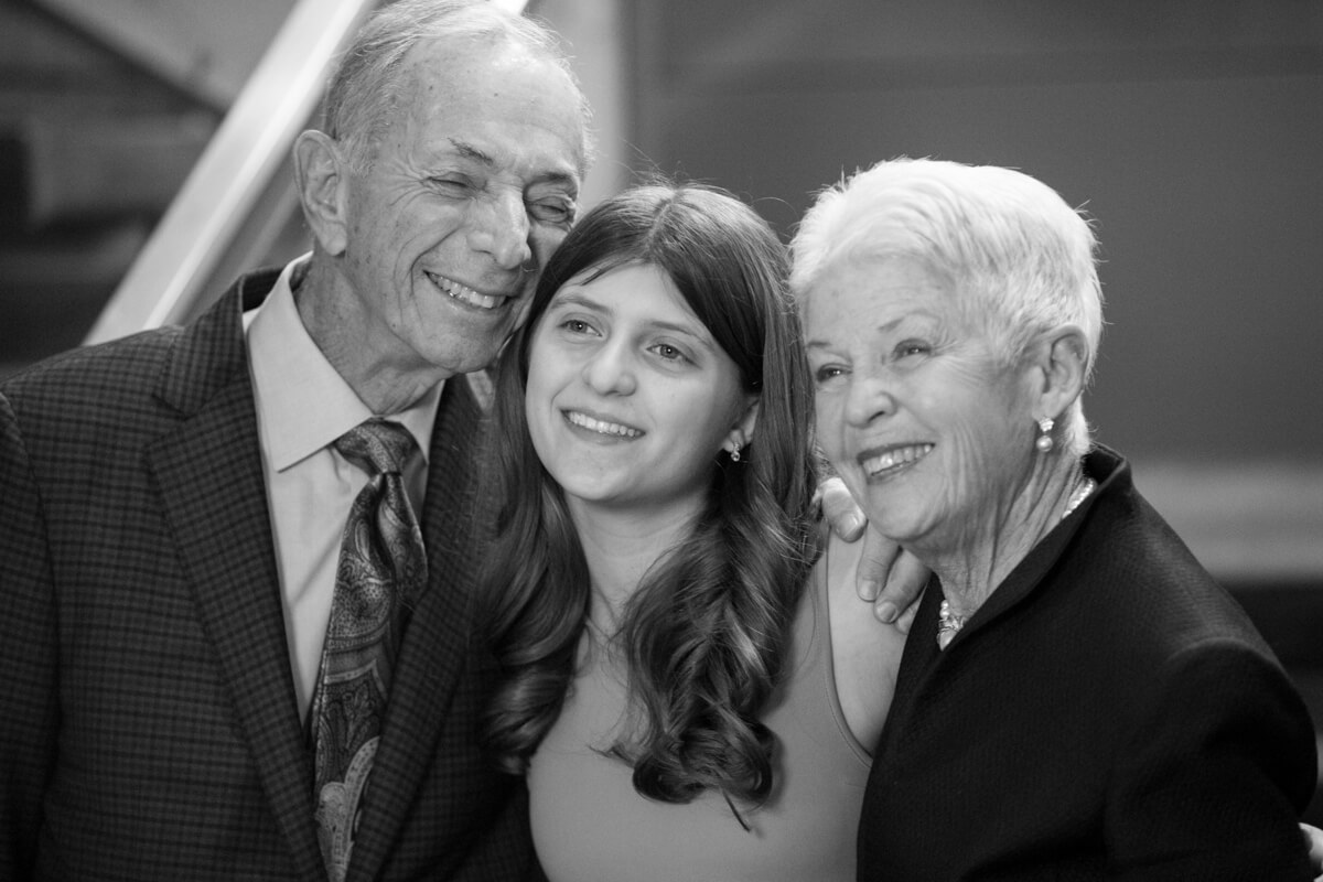 Candid photo with grandparents at Bat Mitzvah
