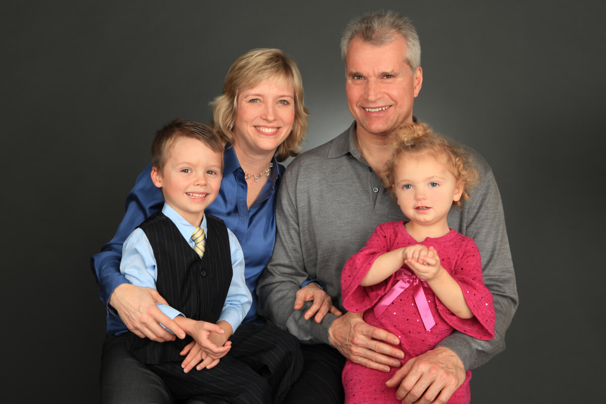 Family Portrait in Studio with grey backdrop