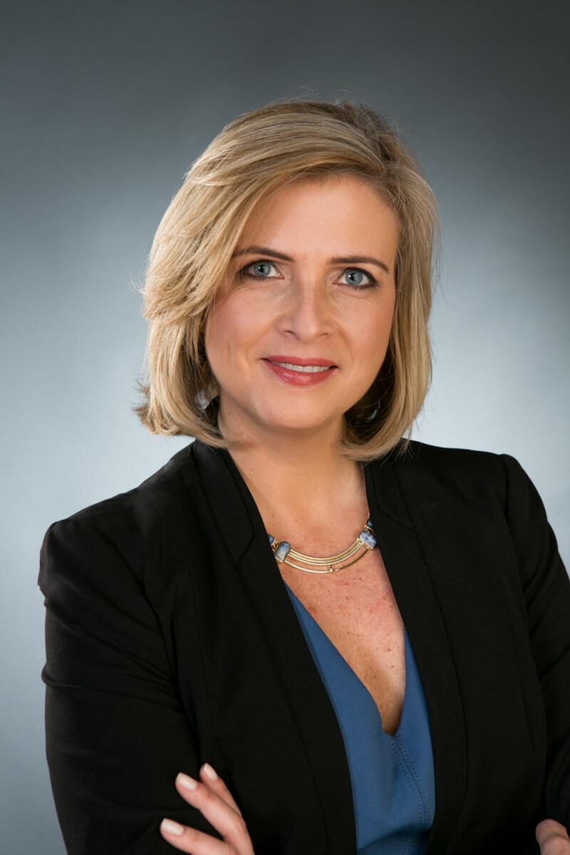 Monika Lotter Headshot in Studio with gray backdrop
