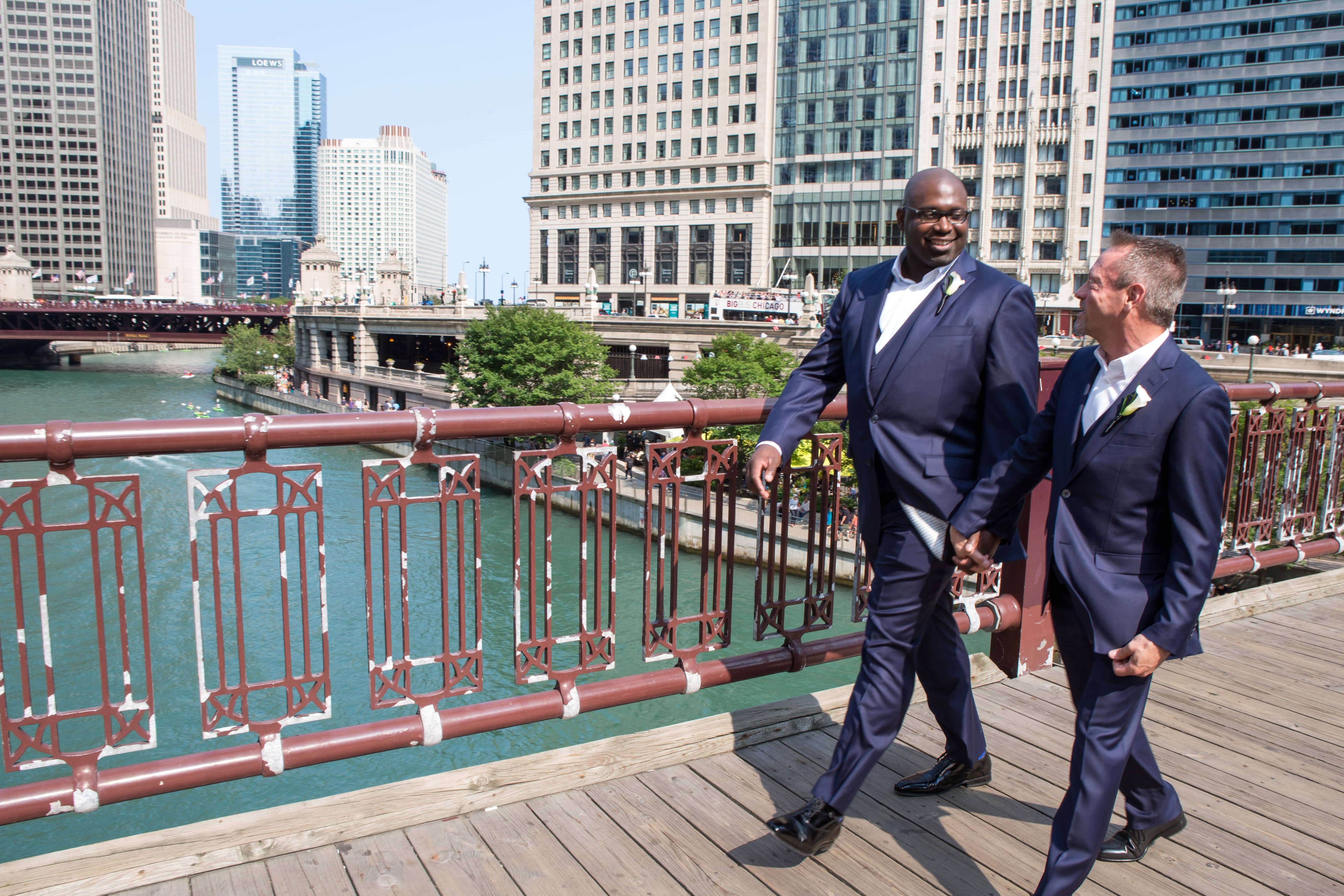 LGBT Wedding Couple crossing the Chicago River bridge