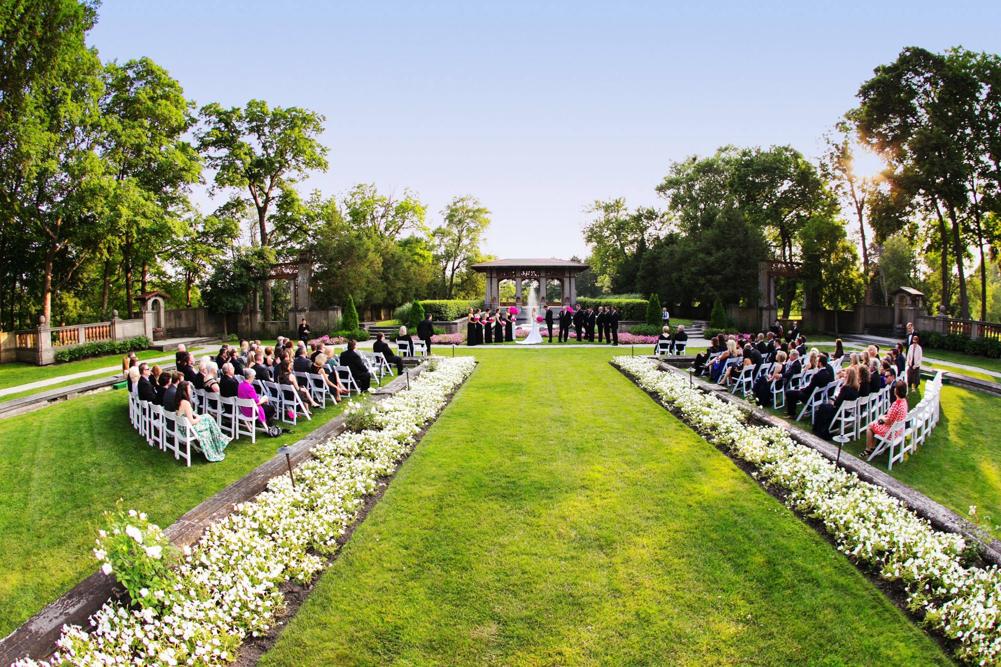 Wedding ceremony in the gardens of the Armour House