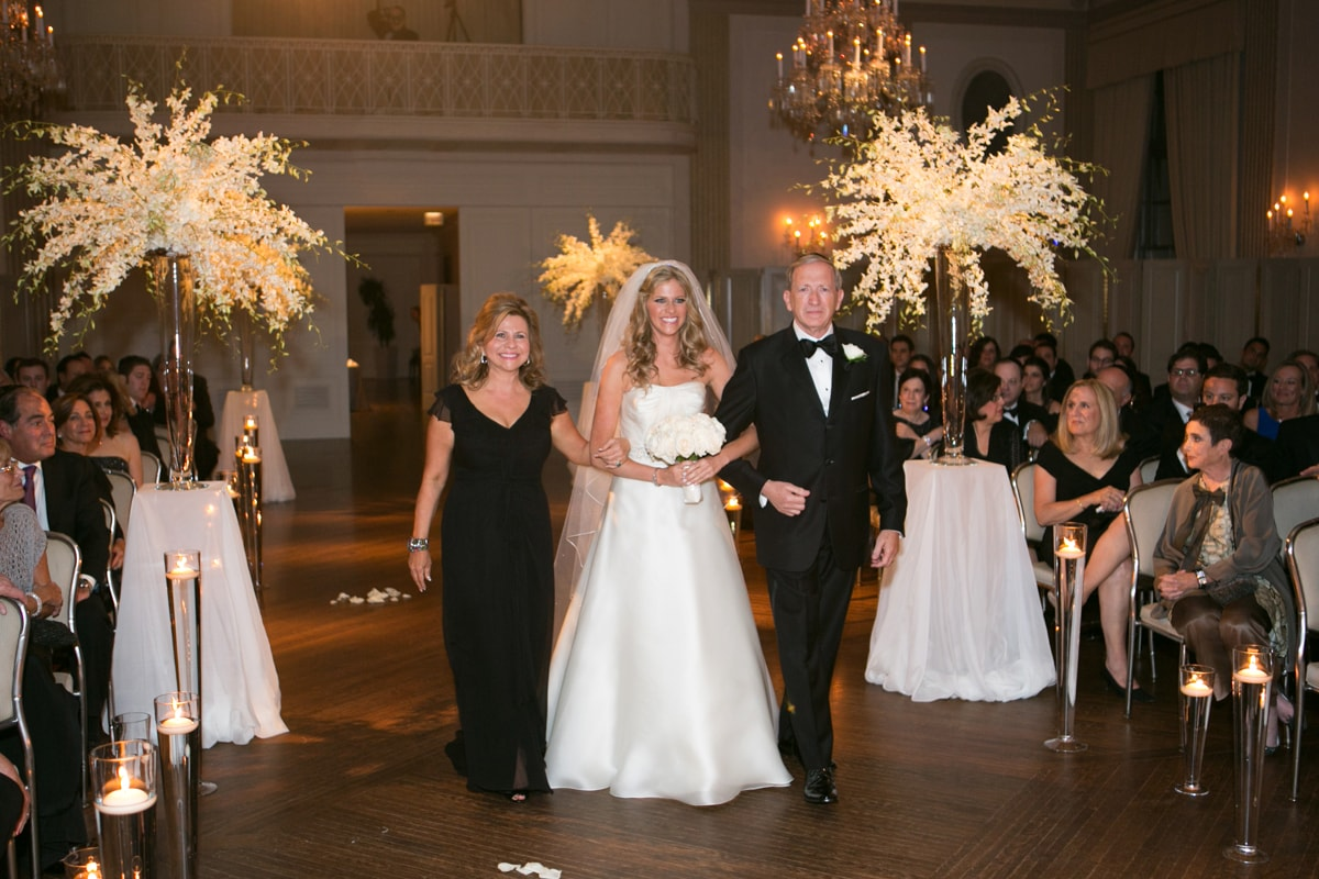 Bride enters wedding ceremony with parents at Standard Club Chicago