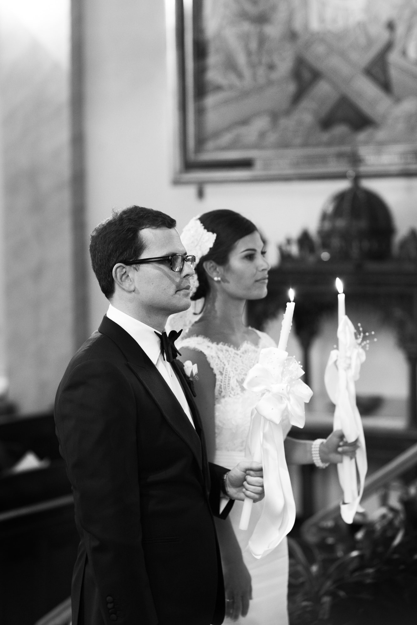 Candle light during Greek wedding ceremony