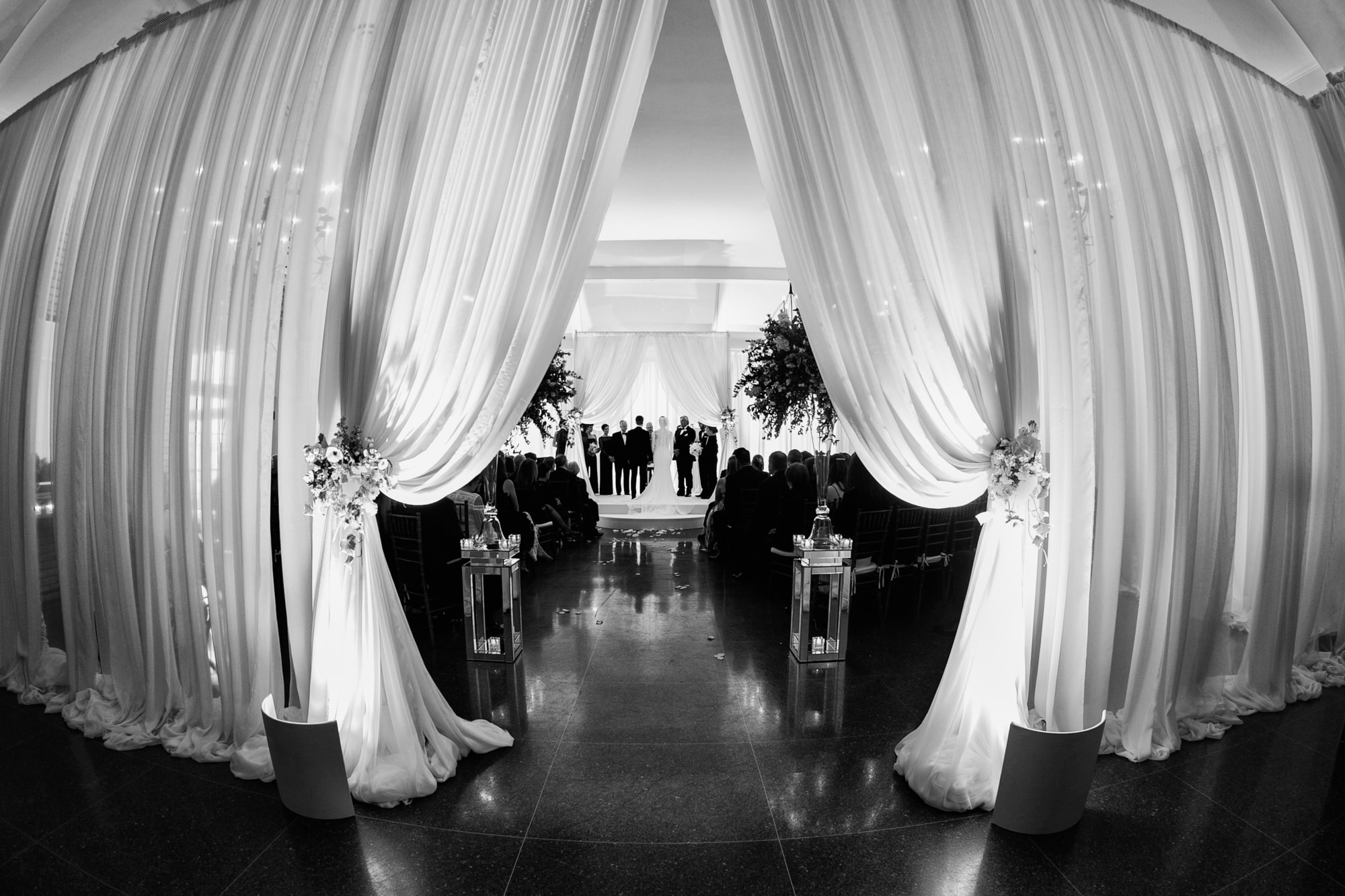 Dramatic black and white photo of wedding ceremony