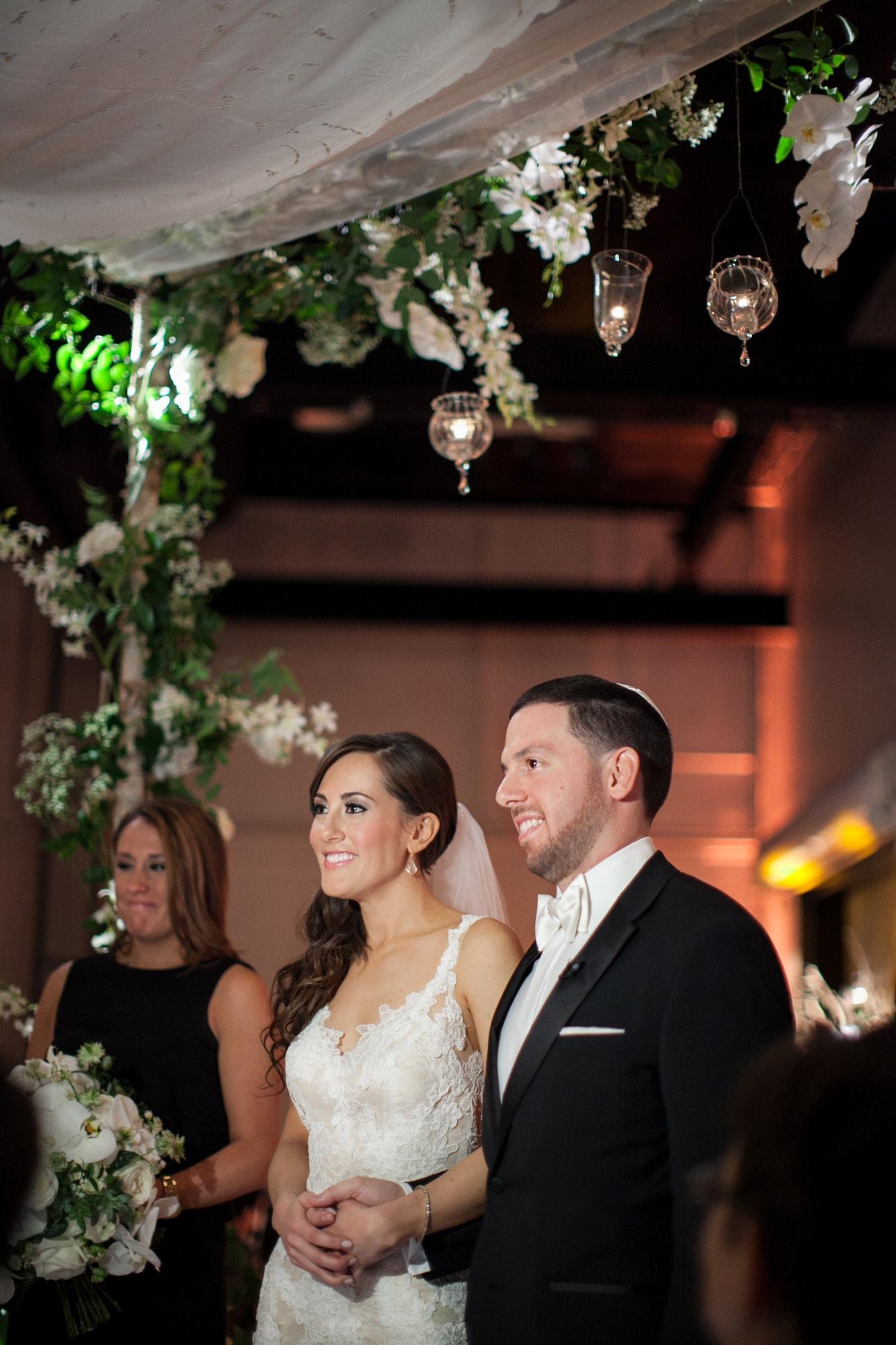 Floral huppa at Jewish wedding ceremony