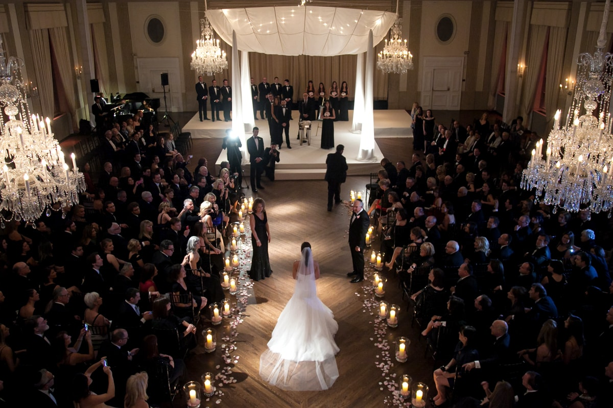 Dramatic entrance by bride during wedding ceremony