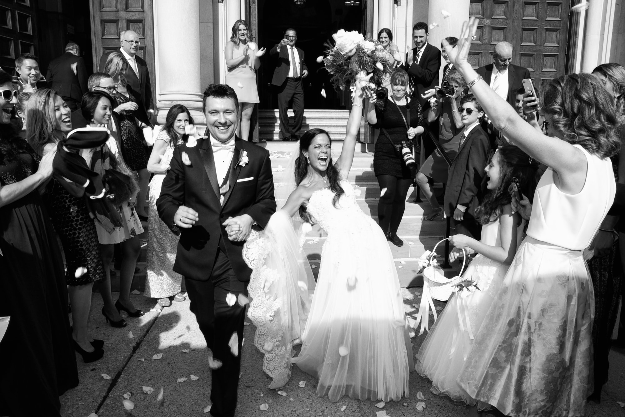Bride and Groom exit Greek church after wedding ceremony