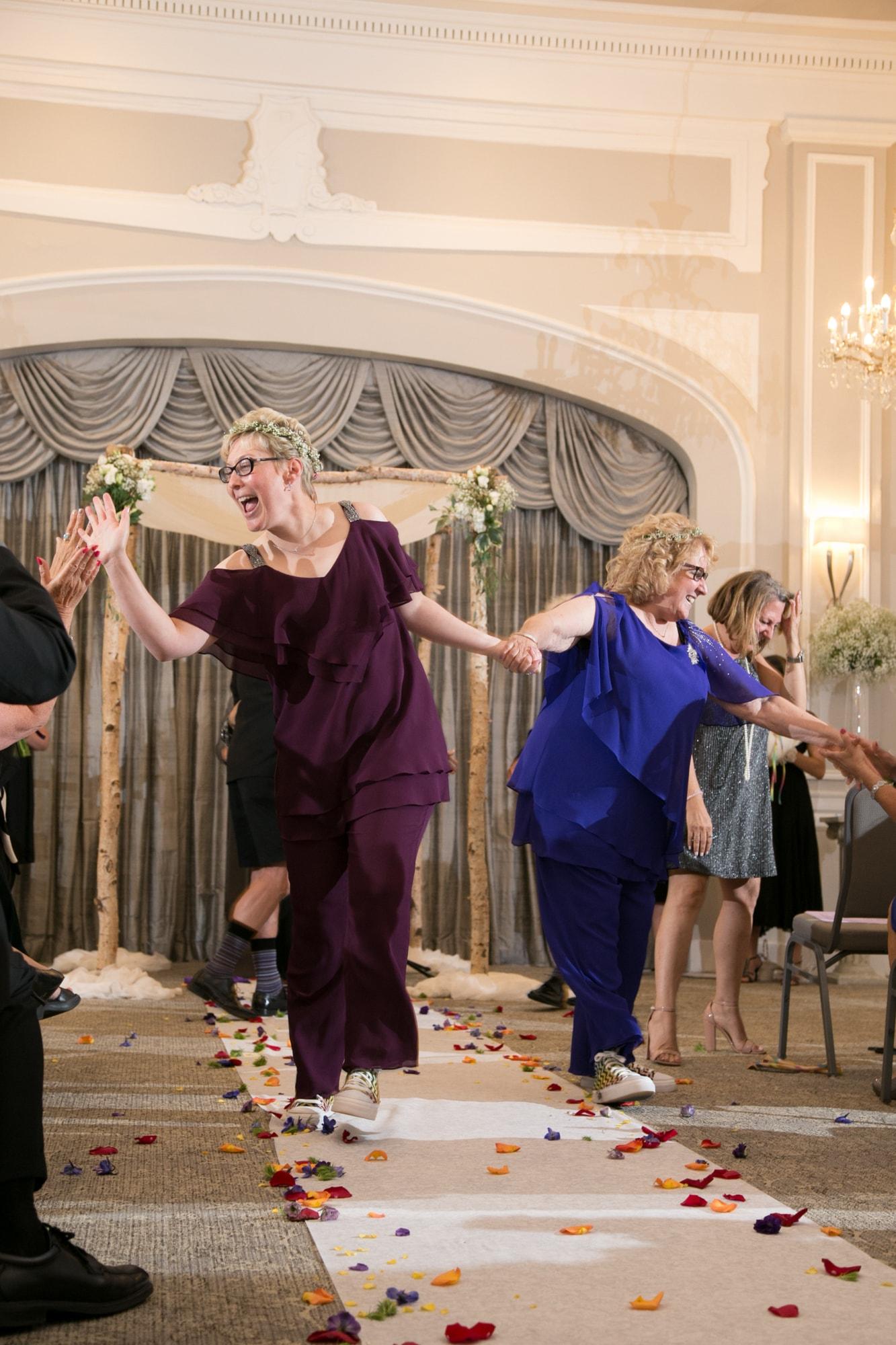 Happy brides dancing after the wedding ceremony