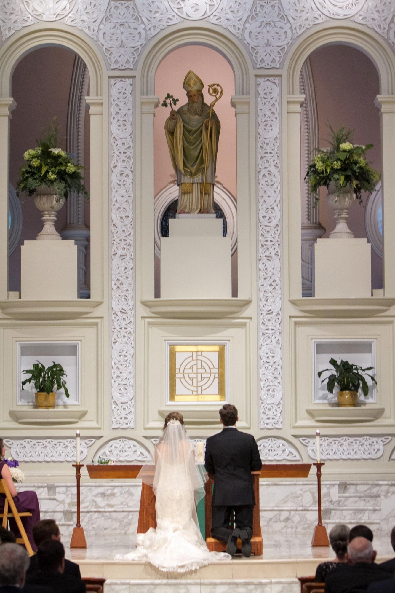 Prayer during wedding ceremony at Old St. Patricks Chicago