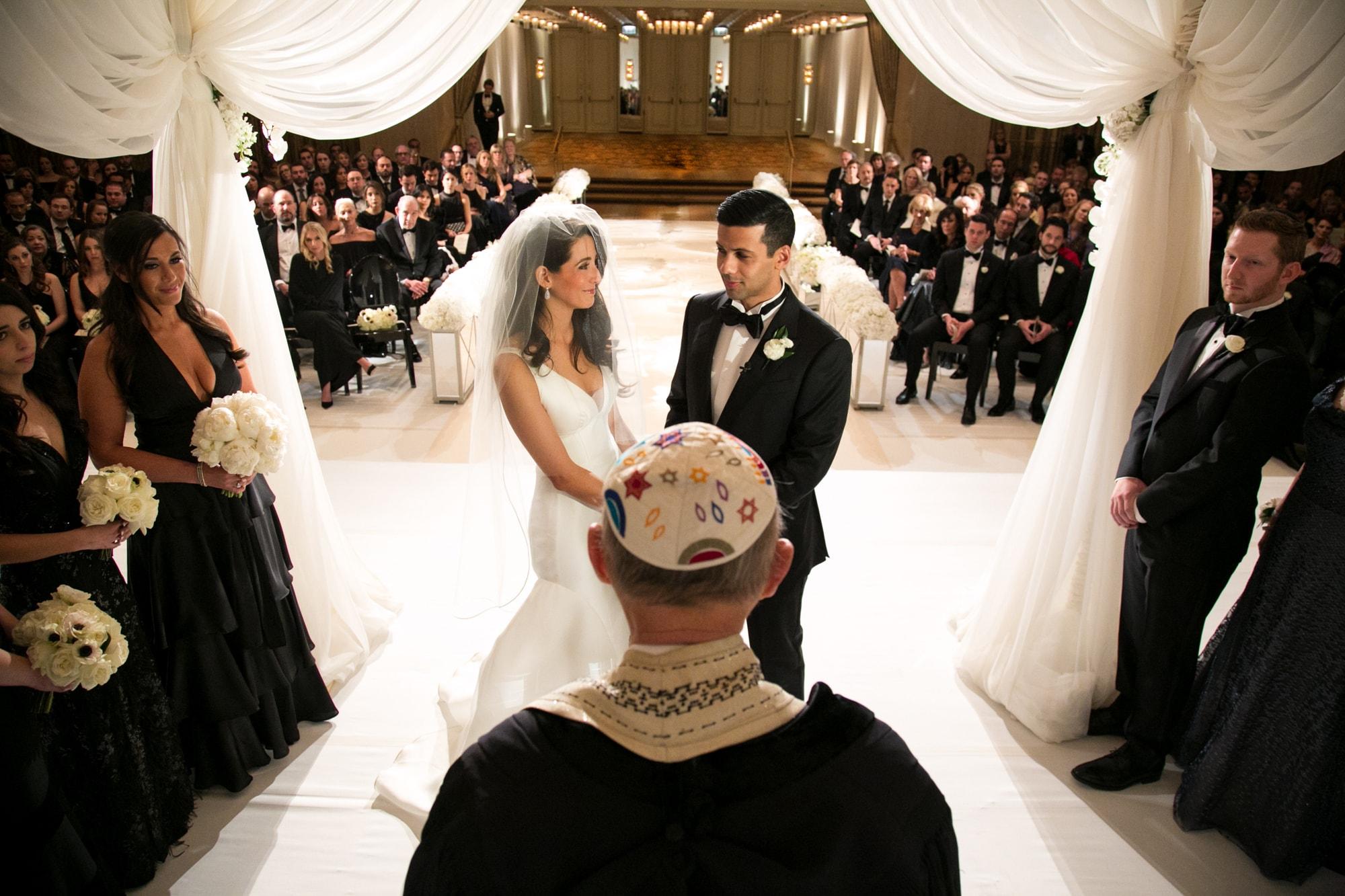 Pretty huppa photograph during wedding ceremony