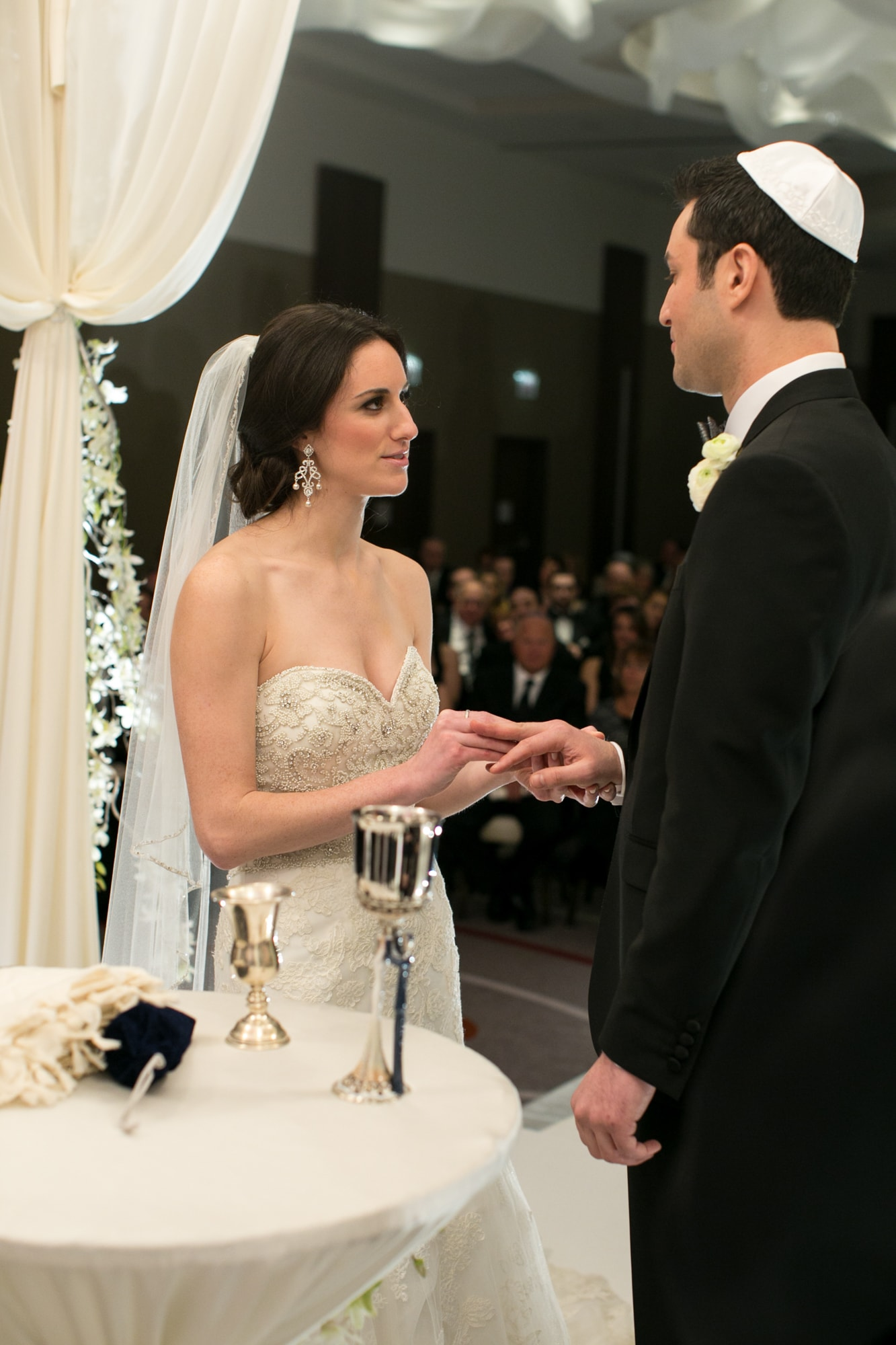 Exchanging rings during a wedding ceremony.