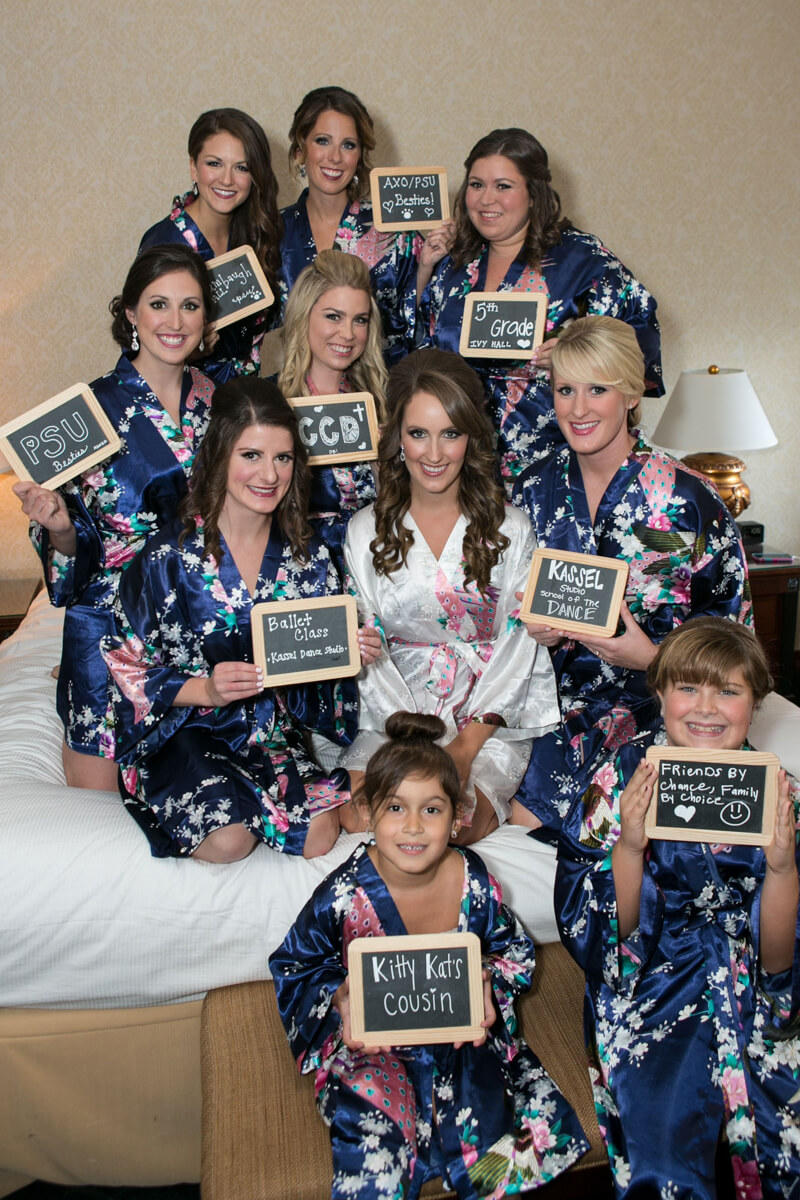 Bridesmaids with chalkboard and special robes