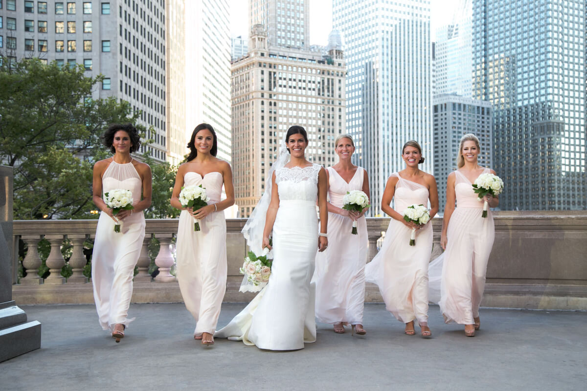 Bridesmaid walk in fun candid in Chicago