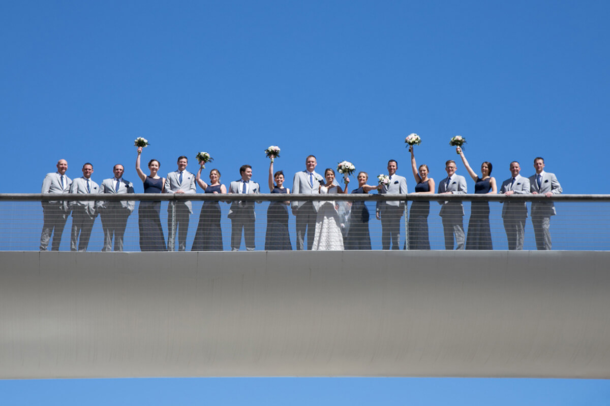 Wedding party portrait on bridge at Chicago's Millenium park