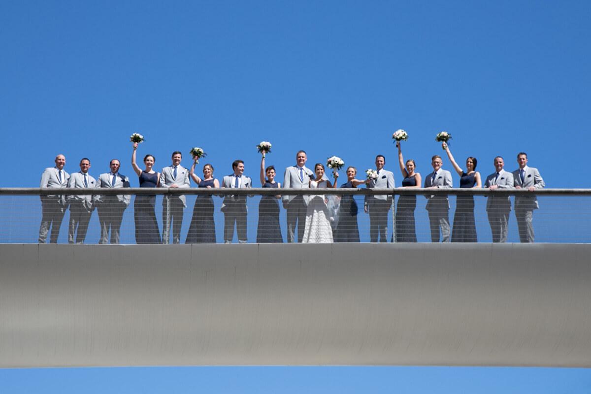Wedding party portrait on bridge at Chicago's Millenium park