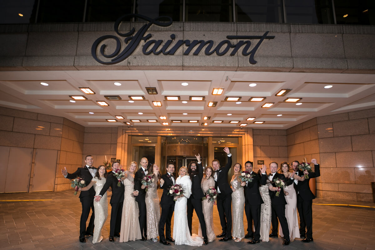 Wedding Party poses in front of the Fairmont Chicago