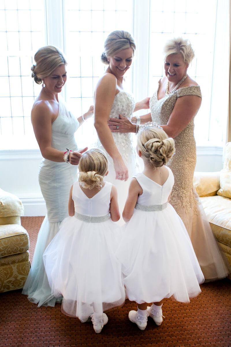 Flower girls watch bride getting ready