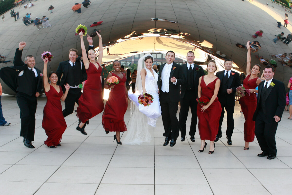 Wedding Party jumps in front of Chicago's Bean