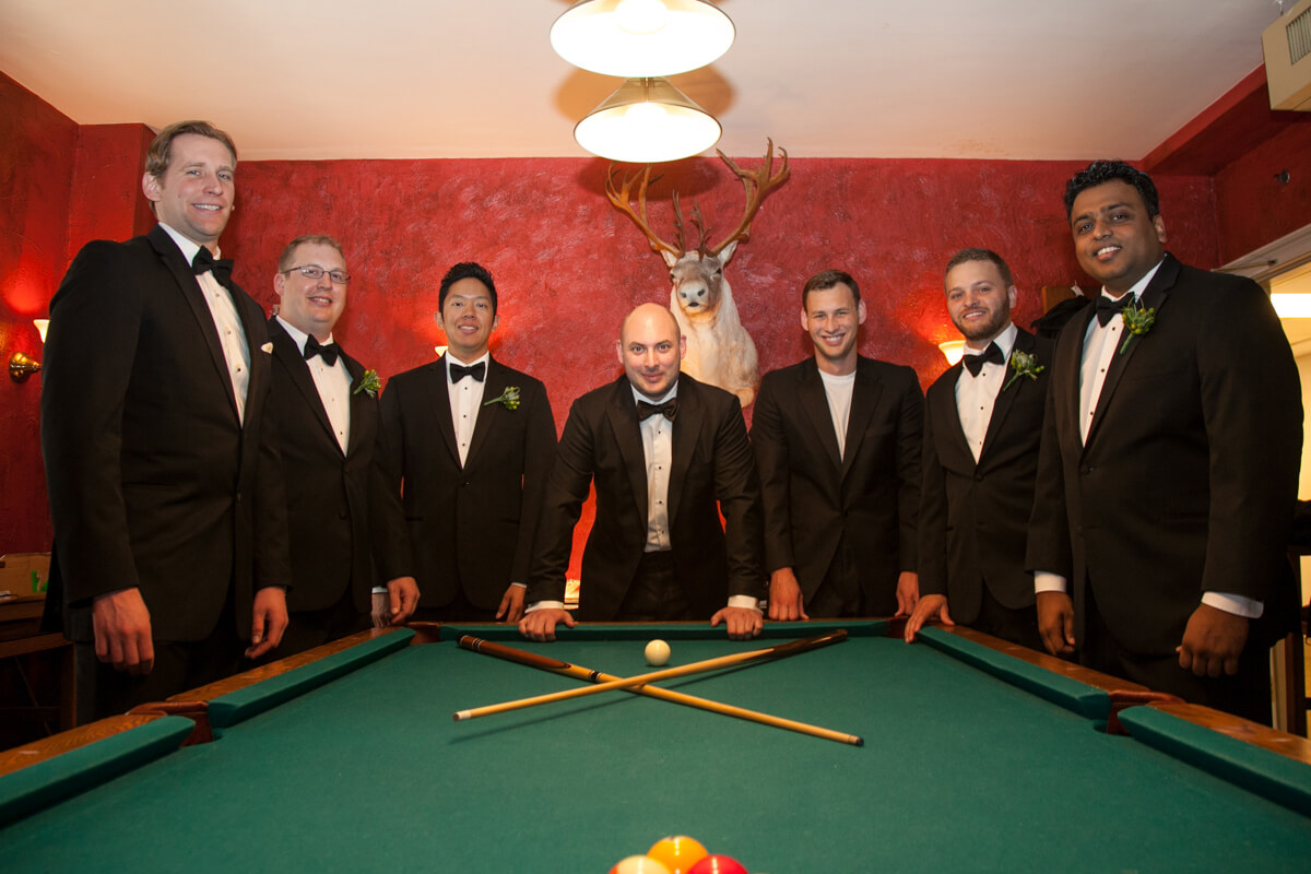 Creative photo of groomsmen playing pool