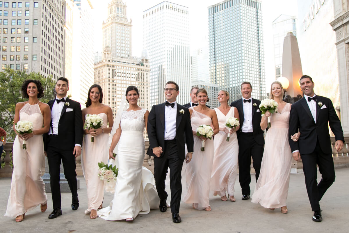 Candid walking photo of bridal party in Chicago