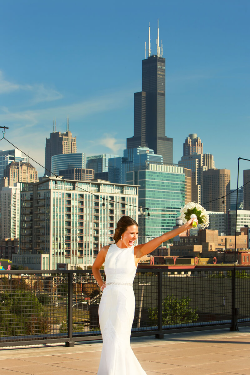 Candid bride in front of Chicago Skyline