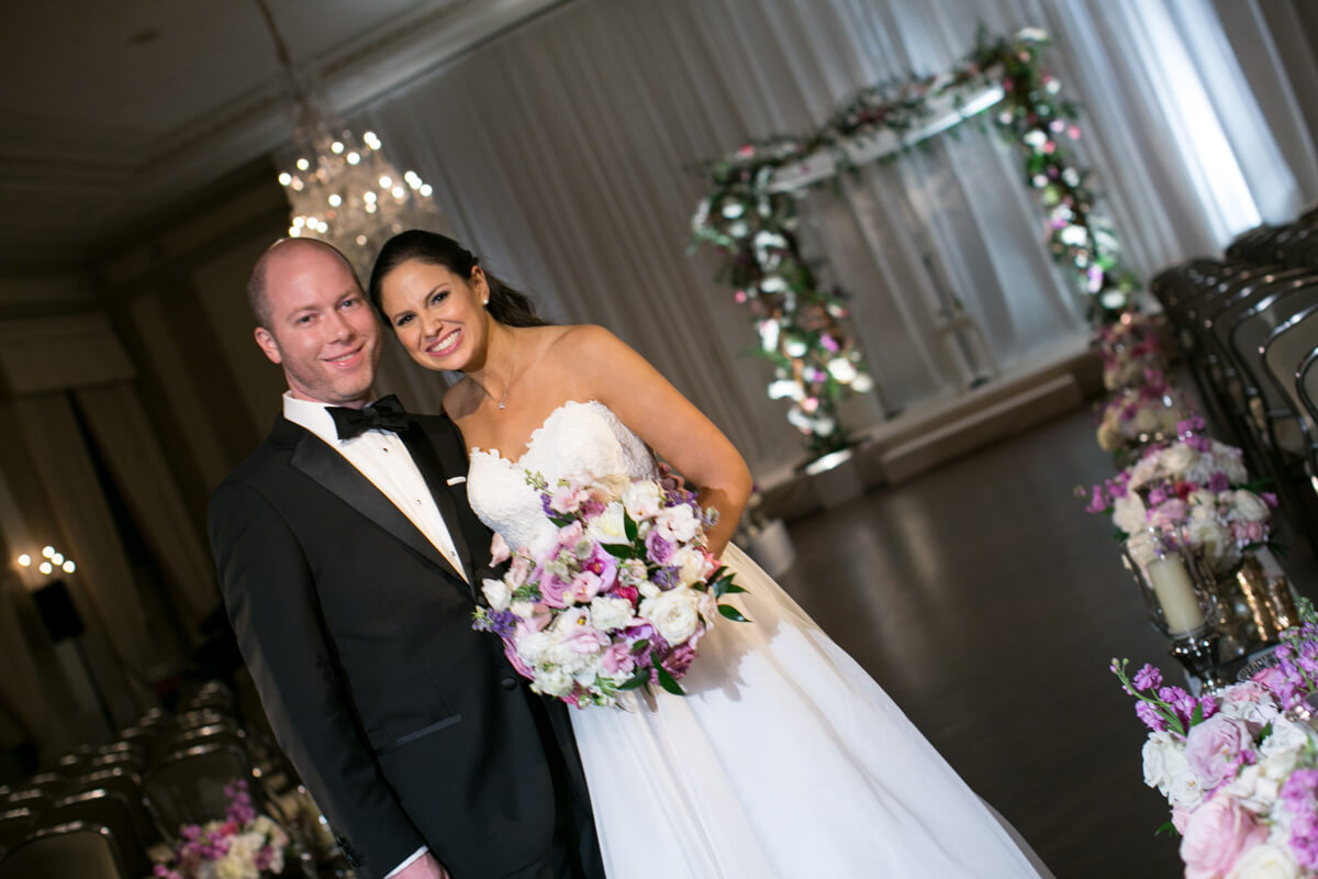 Colorful wedding portrait in front of huppa