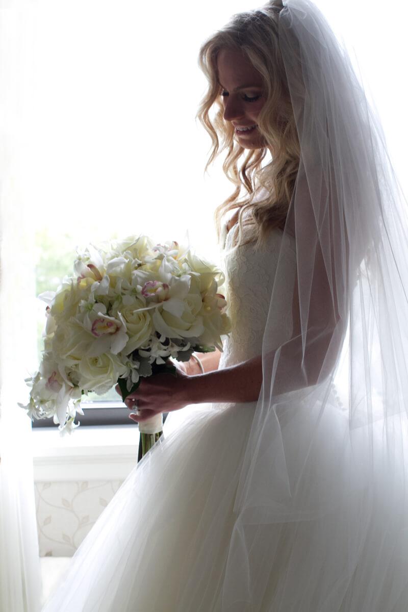 Wedding Portrait of bride with romantic floral bouquet