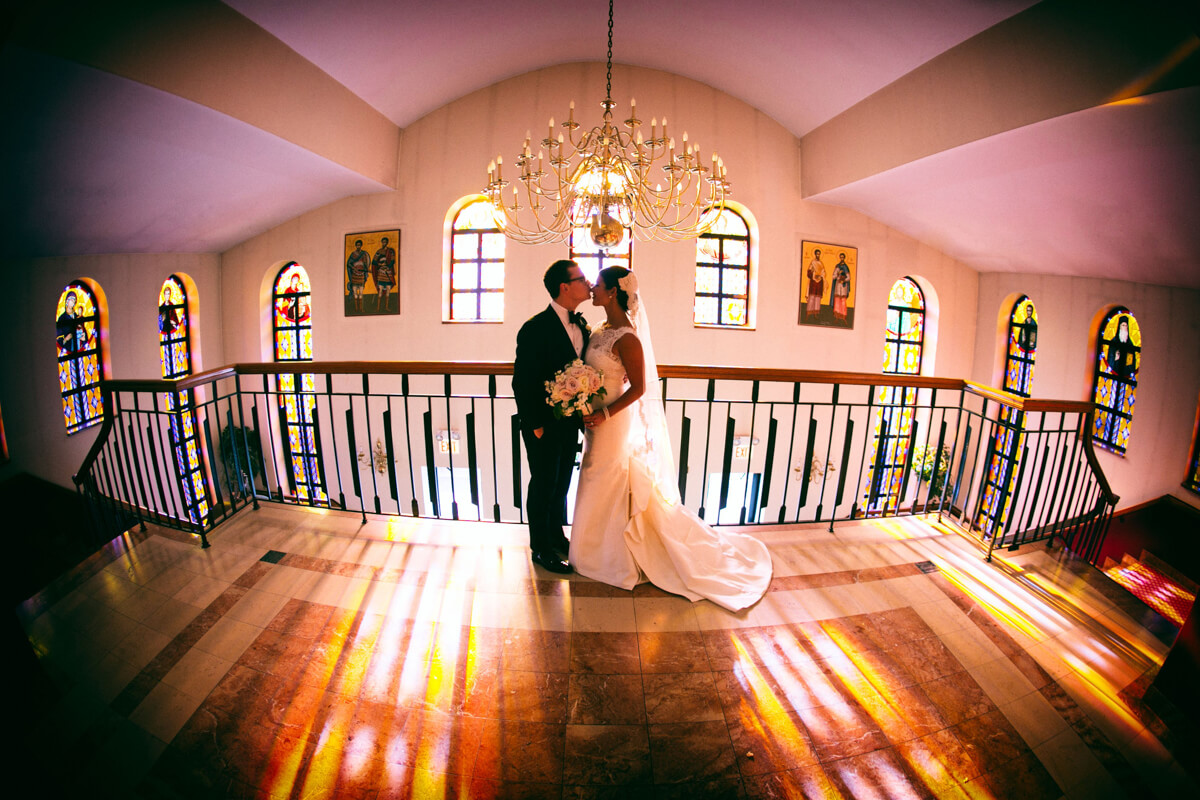 Stained Glass backdrop of bride and groom's portrait