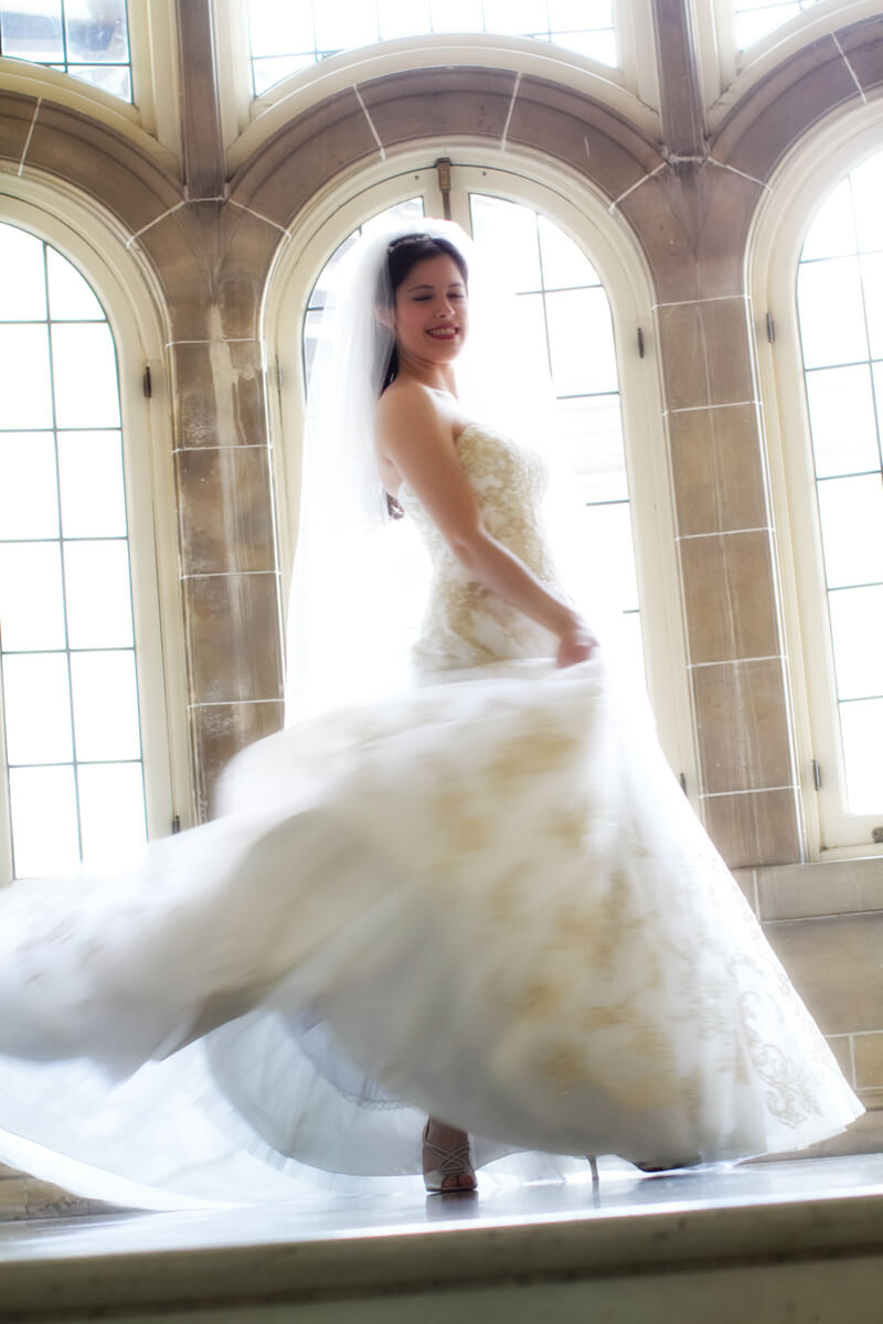 Bride twirls dress on stairs of Armour House