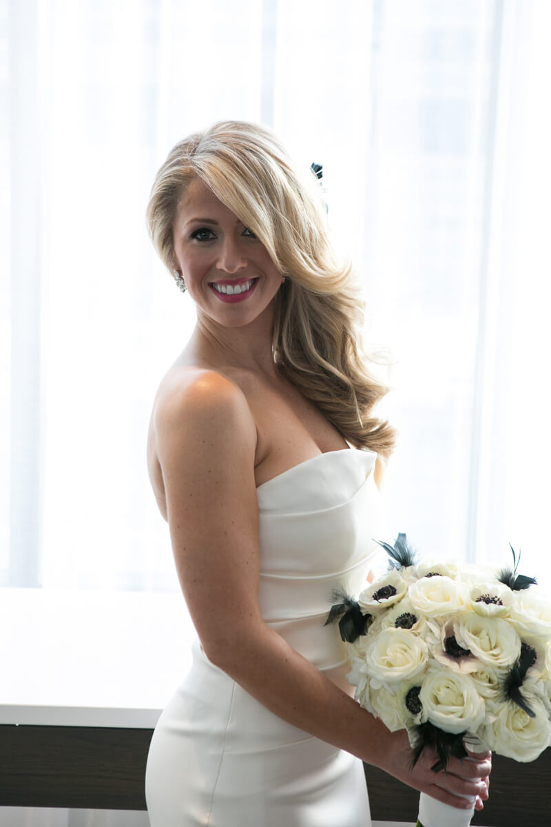 Bride poses with window light