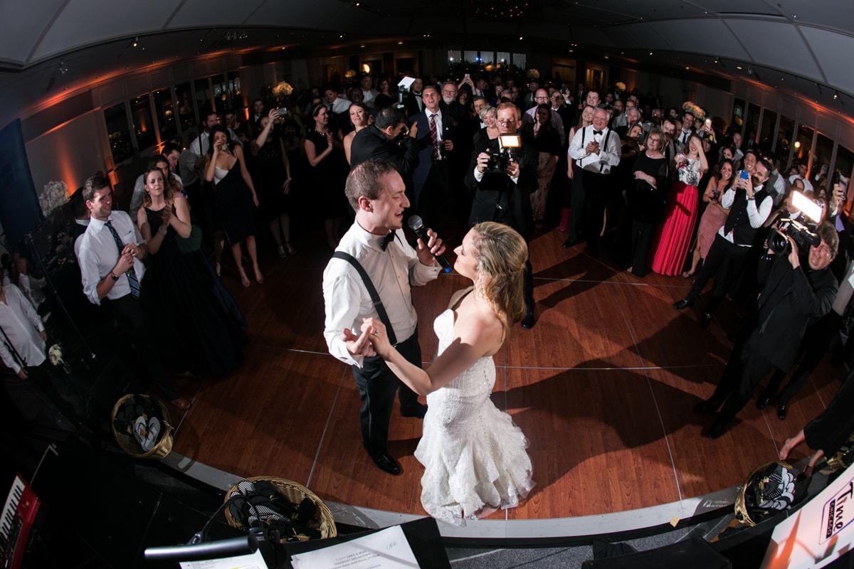 Groom sings to bride at wedding reception
