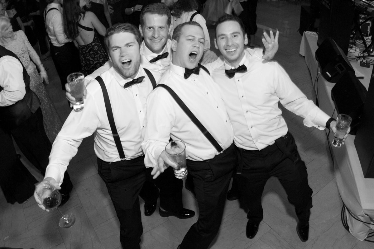 Guys dancing at a wedding reception