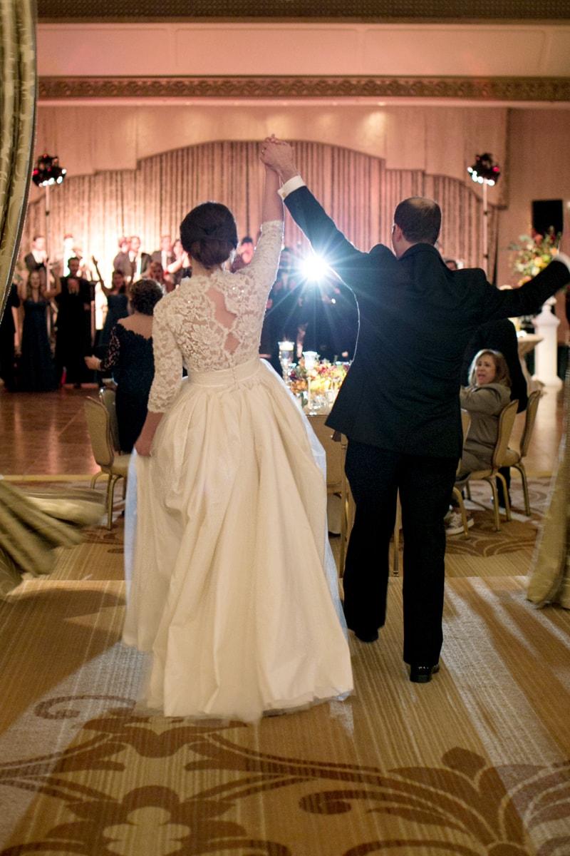 Bride and groom enter the reception at the Ritz Calton