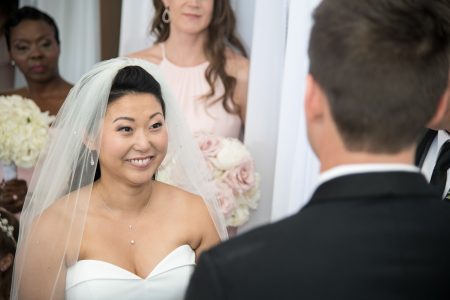 bride smiles during ceremony at spiaggia