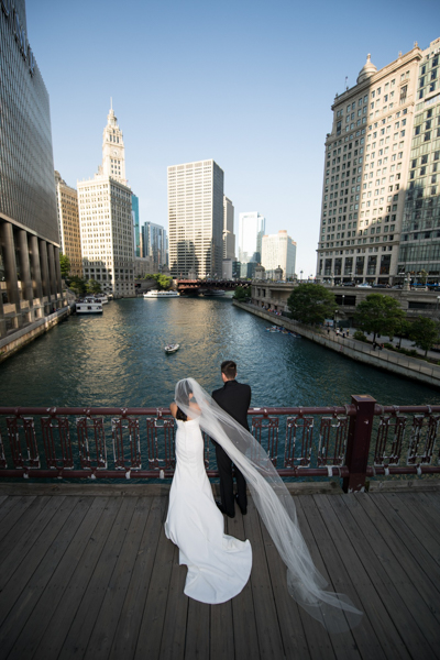 bride and groom at chicago river