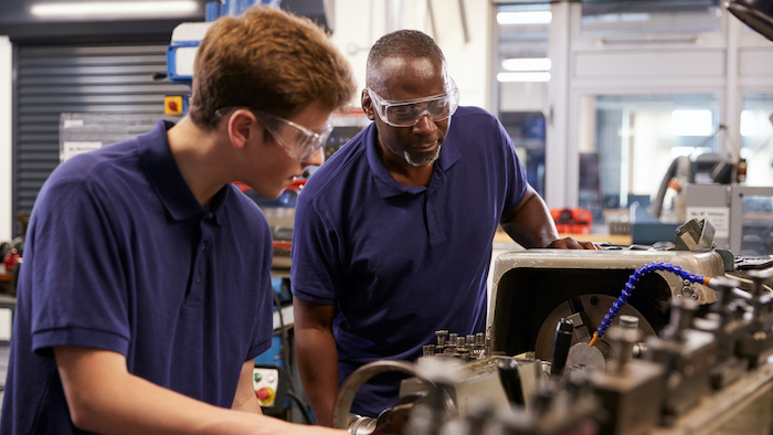 engineer showing intern machinery Maverick Institute