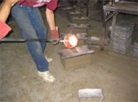 Hand Forging a Strap Hinge.